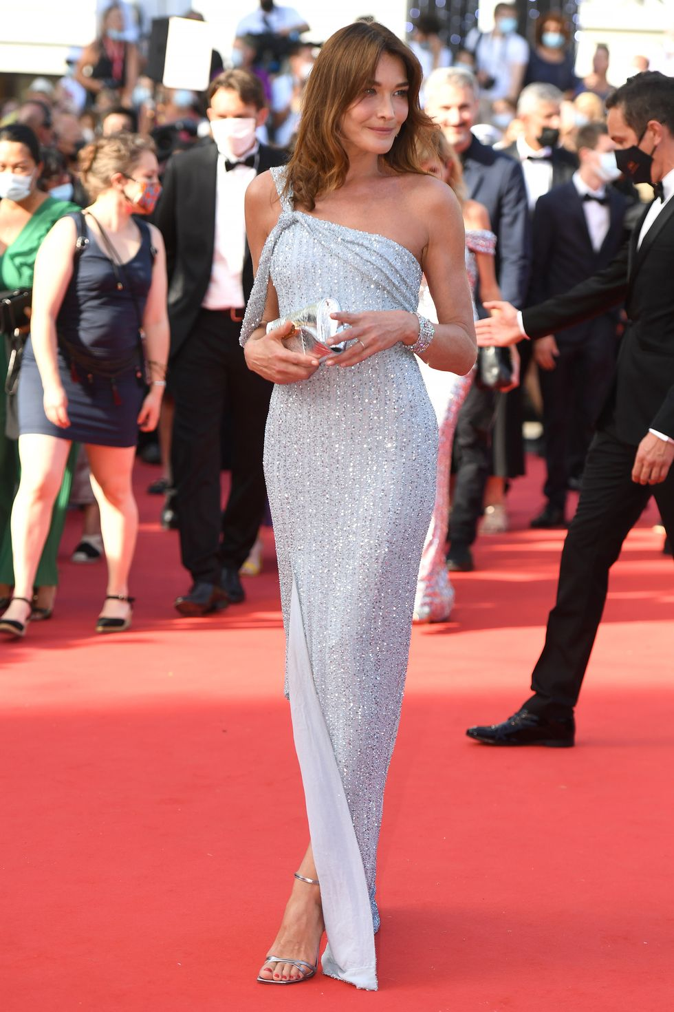 Carla Bruni Carla Bruni chose a one-shoulder sequin dress by Celine, and heels in the same color as the dress.