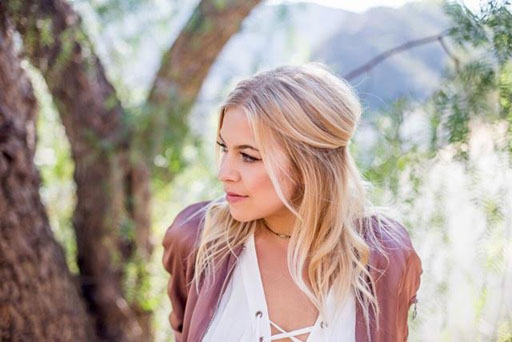 "Acclaimed Canadian pop singer/songwriter Maggie Szabo drops her moving and uplifting new music video, ""Don't Give Up On Love."""