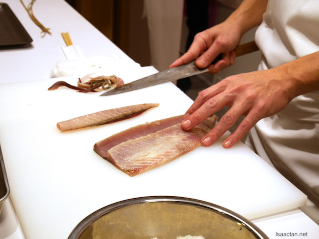 Cutting and slicing the mackerel