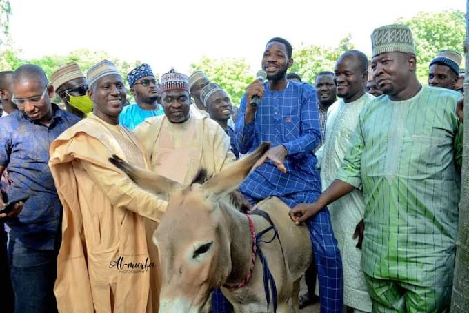 Governor Ganduje's aide shares donkey and other items to empower Kano youths
