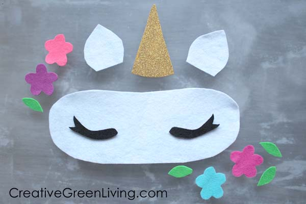 Cut felt for the unicorn horn, ears and crown from the free printable unicorn sleep mask template