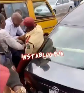 Elderly man Fights  LASTMA officers who tried to tow his car (Video)