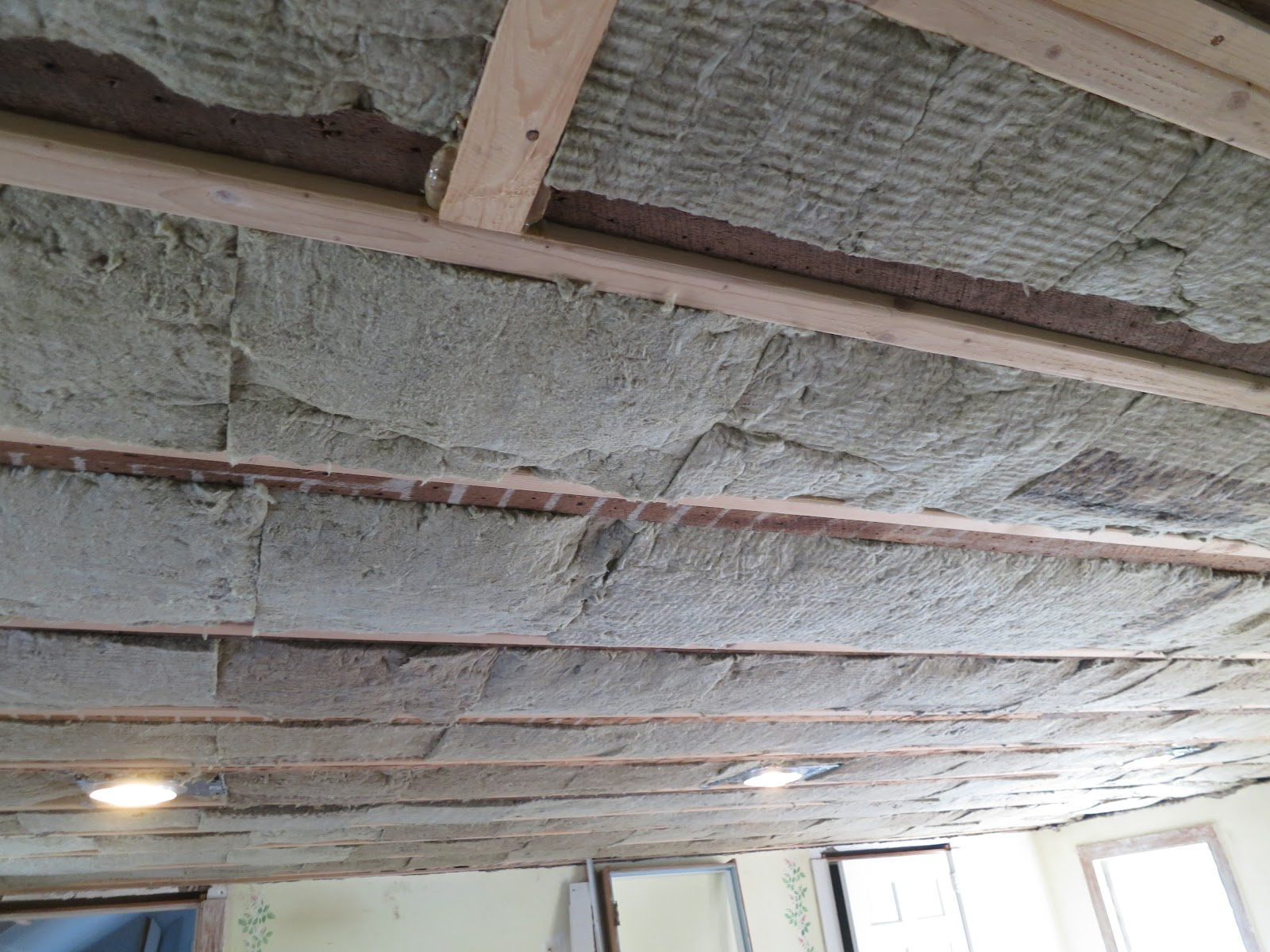 An old farm insulating the ceilings for Mold resistant insulation