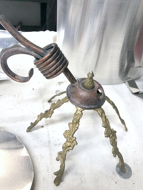 Repurposed metal lamp parts garden bee