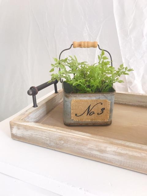 galvanized pail wooden handle faux green plant burlap