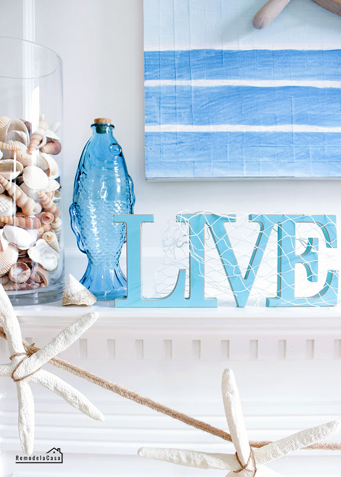 Blue and white summer mantel with seashells