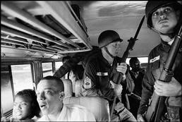 Freedom Riders Julia Aaron and David Dennis, with National Guardsmen, on a   bus to Mississippi, May 24, 1961. (Photo by Bruce Davidson, Magnum)
