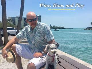 Crab Daddy's restaurant in St Pete Beach, Florida is the backdrop with Wine Dine And Play with our dog