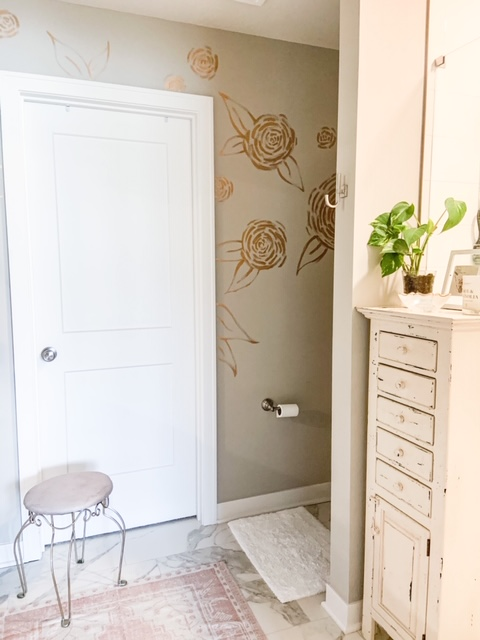 gold painted flower wall treatment