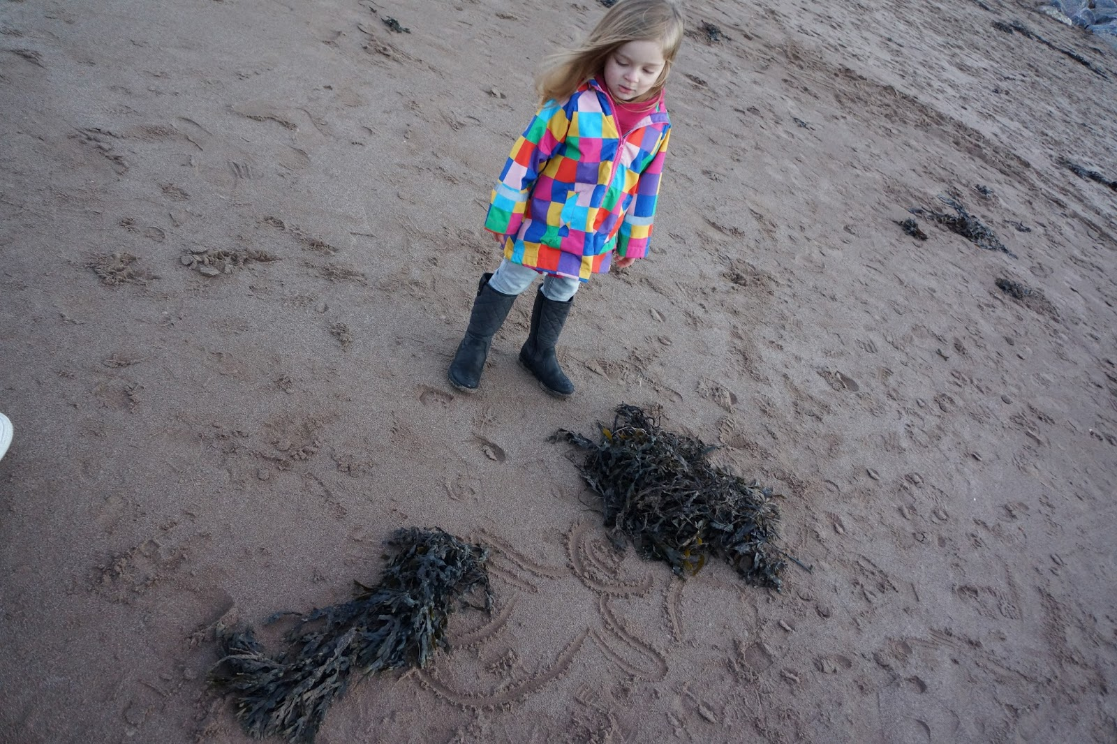 seaweed mermaid on sand at beach at butlins minehead