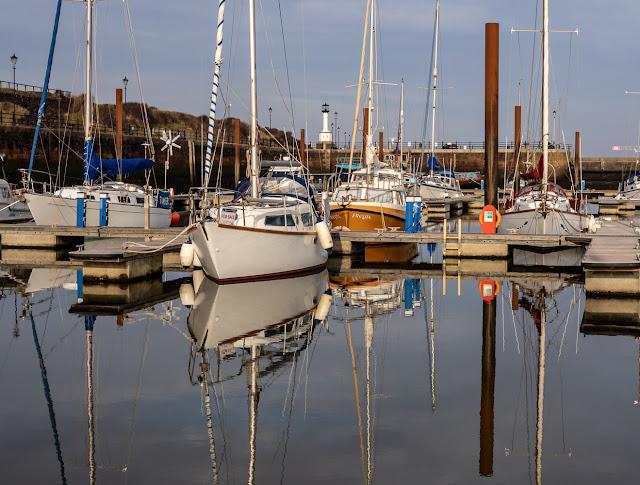 Photo of more boat reflections as Maryport Marina