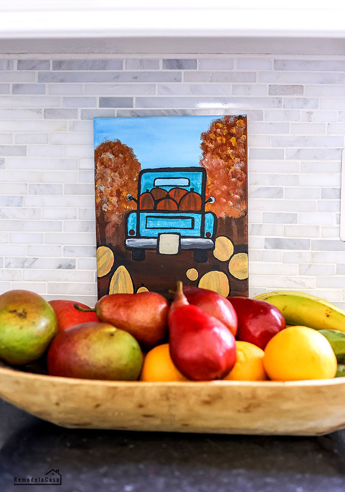canvas painting of blue truck full of pumpkins
