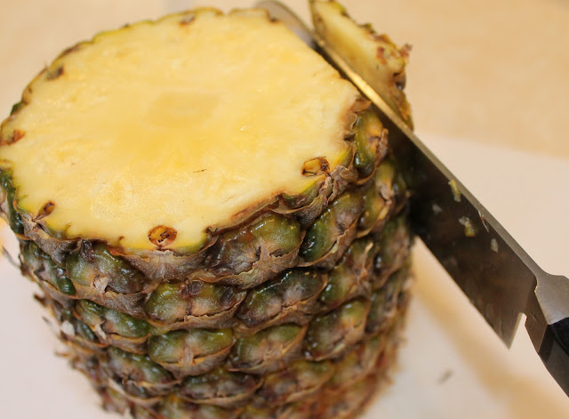 The Second Step in Preparing a Fresh Pineapple is to Slice the Skin.
