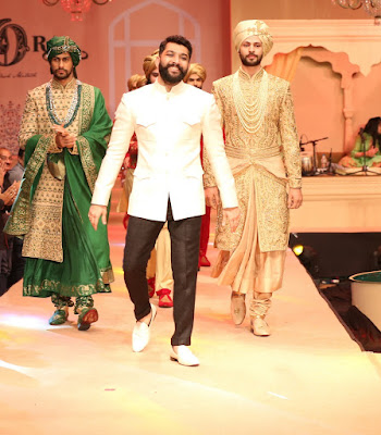 Mitesh walking the ramp with models