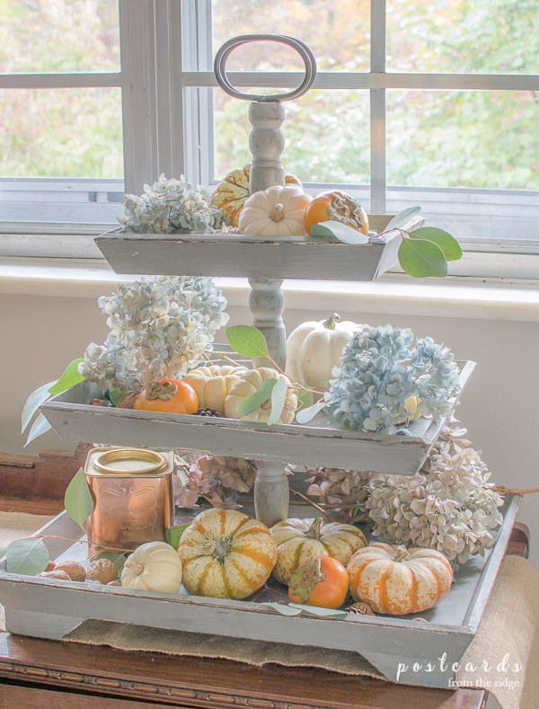 tiered tray with dried hydrangeas and pumpkins