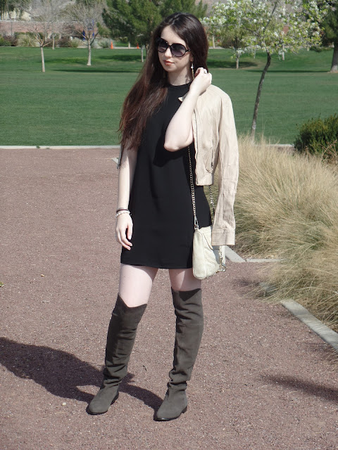 Little black shift dress with boots and a leather jacket