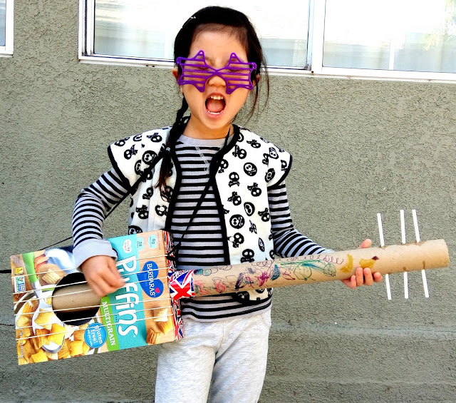 diy cereal box guitar made out of recycle materials. see more photos at growinguphui.com