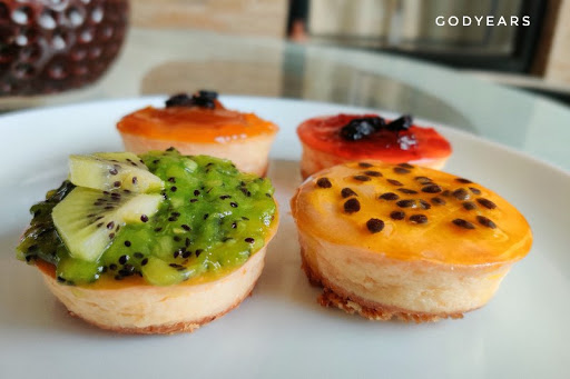 Cheesecakes - passion fruit, mango, mixed berries and kiwi fruit
