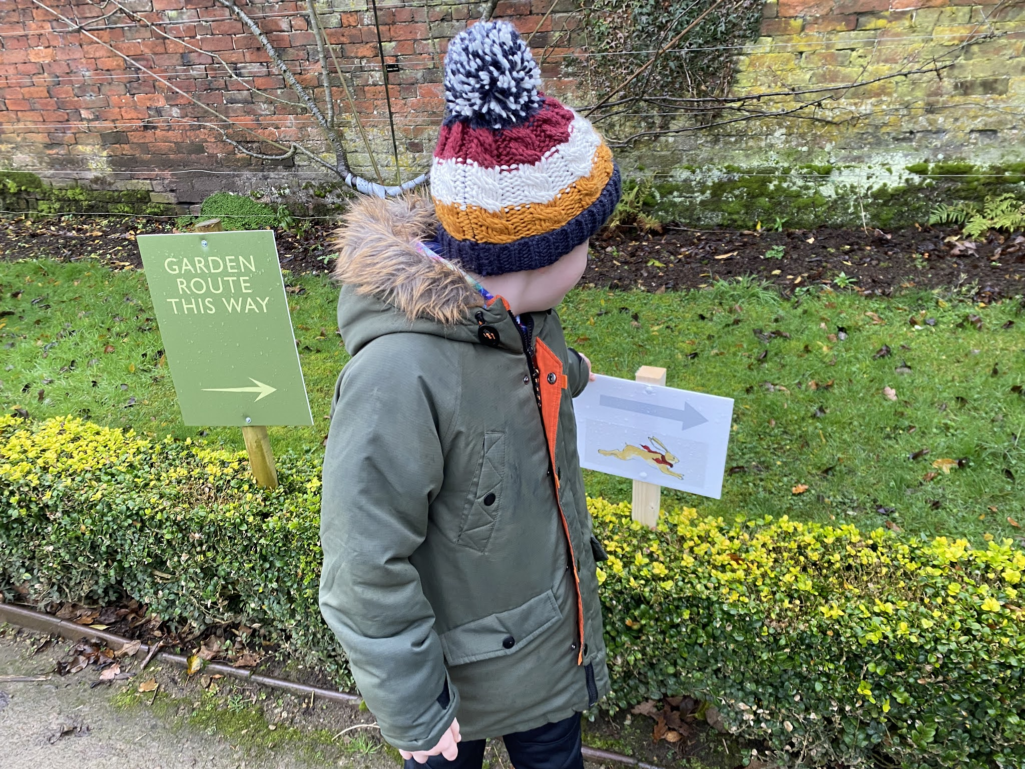 boy looking at an arrow sign