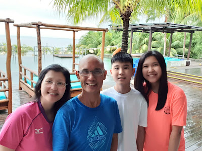 Photo of Rick Wong with family.