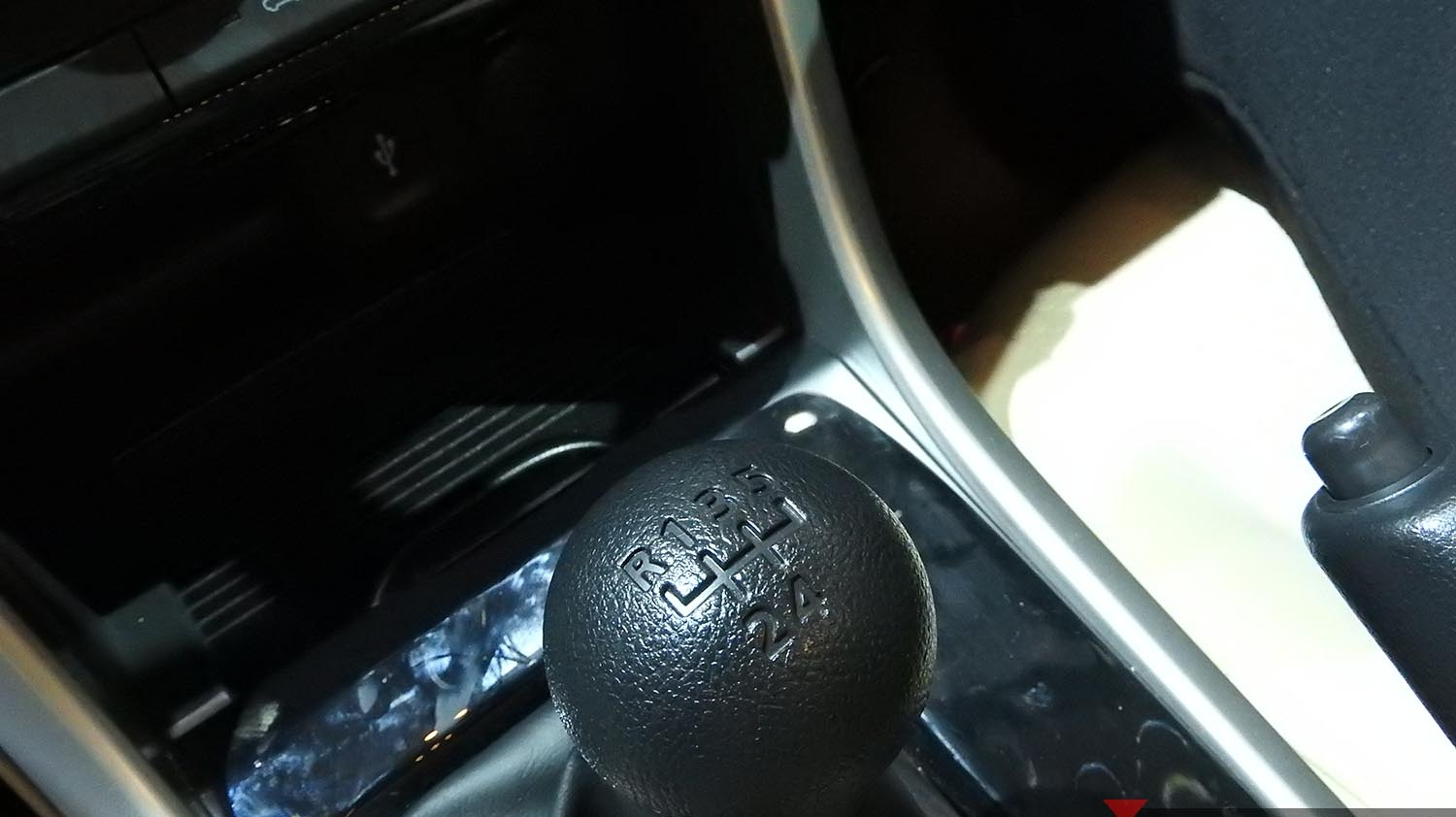 hight resolution of xpander hand brake feels solid and located close to the driver while on his left there are 2 cup holders the center console box capacity is tolerable