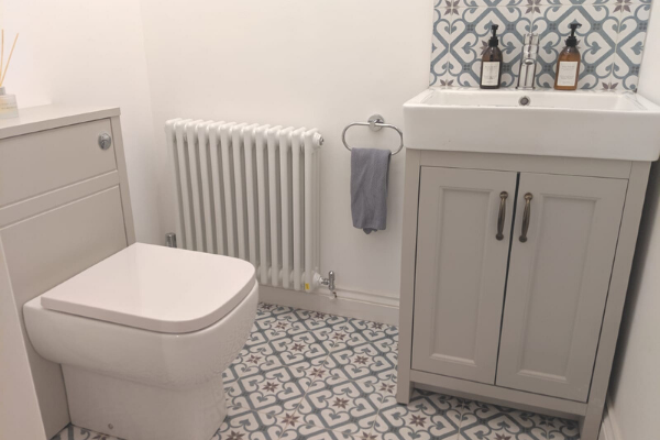grey bathroom with tiled floor