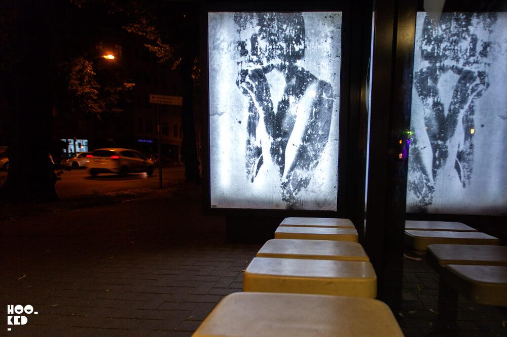 Berlin Street Art - Adbusting with artist Vermibus at night