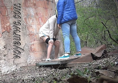 PissWC 266 (Girls peeing outdoors unsuspecting of a voyeur with a spy cam)