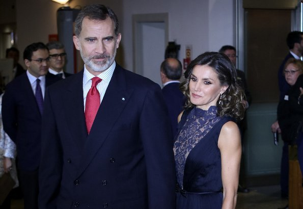 Queen Letizia wore Nina Ricci blue pumps, she carried Felipe Varela clutch bag. Carolina Herrera lace and satin blue dress, diamond earrings
