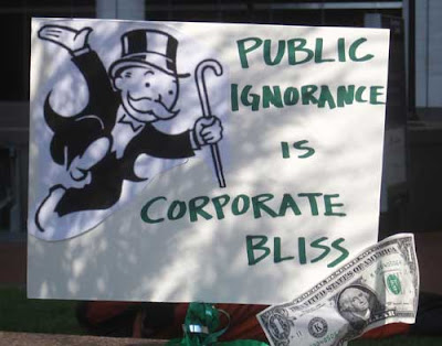 Monopoly's Mr Moneybags with words Public ignorance is corporate bliss