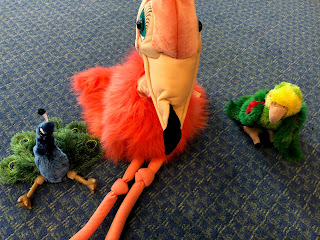 peacock, flamingo, and parrot puppets