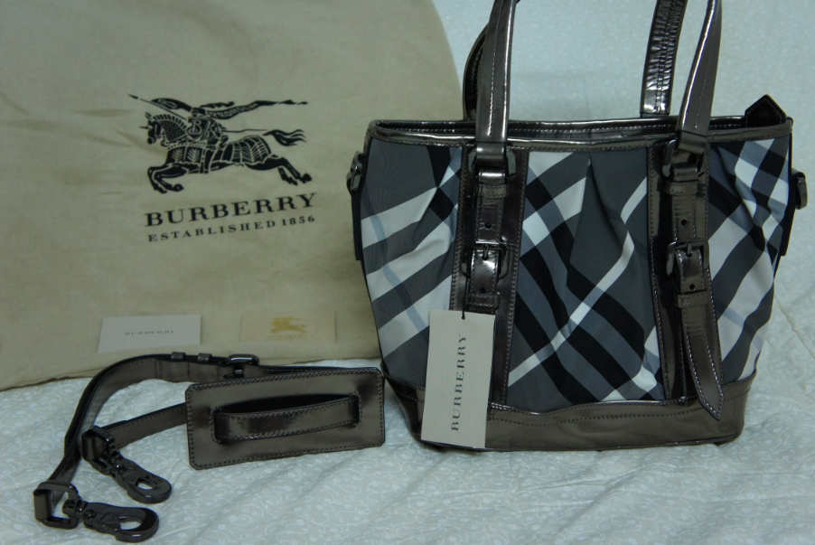 fe1b06e7f Burberry Beat Nylon Lowry Check Tote. SOLD This Burberry bag is available  at the Burberry Boutique The Gardens. Check it out!