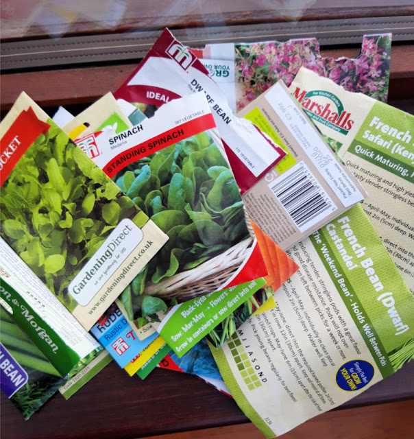Image shows a scattered pile of seed packets