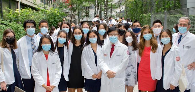 medical students celebrate earning their short white coat