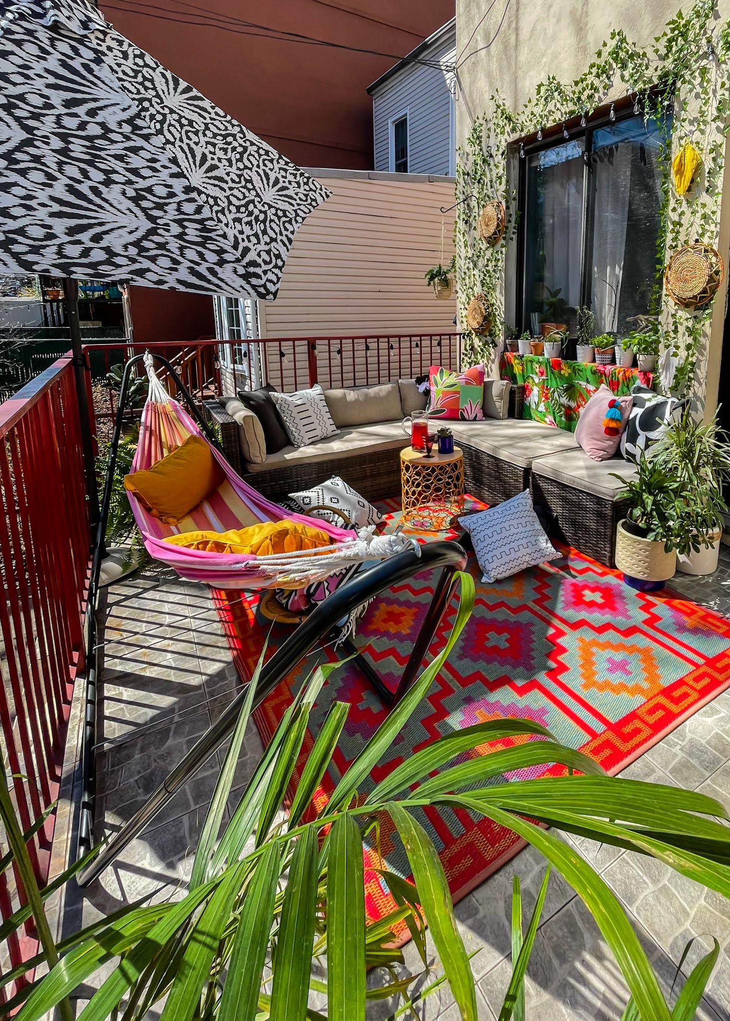 Renter-Friendly Patio Decor,  patio decor, faux ivy wall, command outdoor light clips, patio decor ideas, faux ivy wall diy, small space patio decor, small patio design ideas