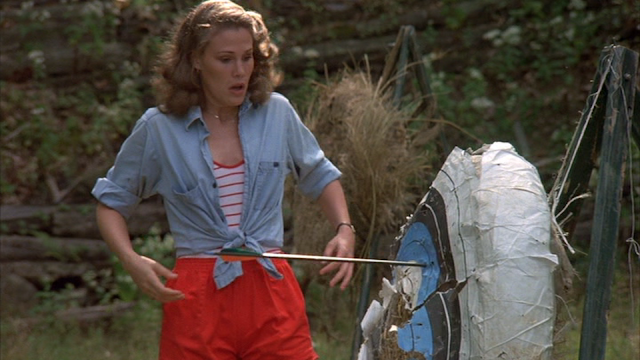 Brenda (Laurie Bartram) at Camp Crystal Lake's archery range in FRIDAY THE 13TH (1980).