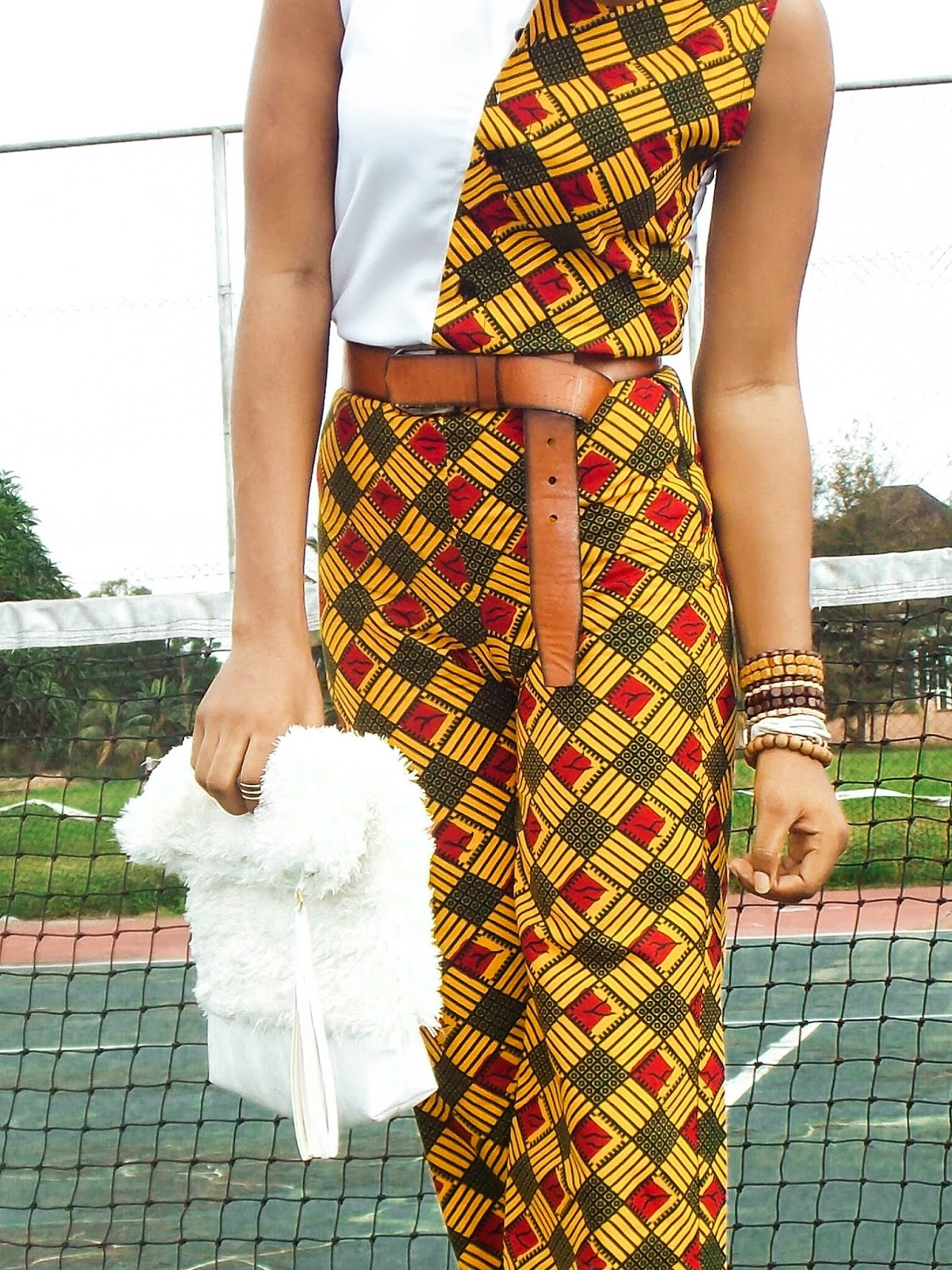 unique way to tie a belt, brown belt on ankara style outfit, african beads/bangles