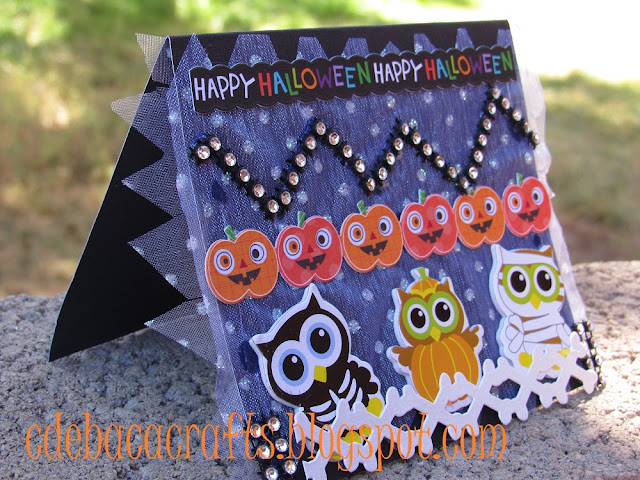 Happy Halloween card with stickers and rhinetones by CdeBaca Crafts.
