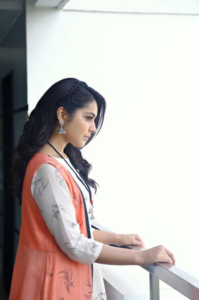 Tollywood Actress Rashi Khanna Photo shoot Images in Orange Top White Dress