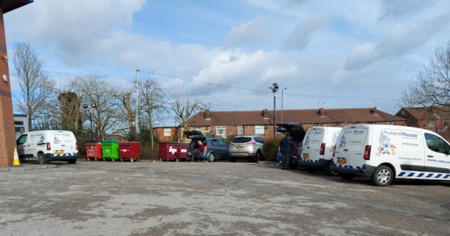 Cars and vans parked in the vet's car park.