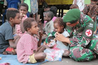 Satgas Yonif MR 411 Gelar Posyandu dan Pengobatan Gratis di Pedalaman Papua