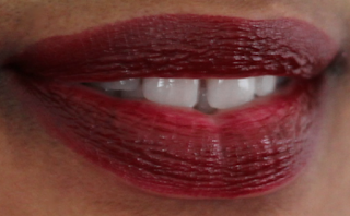 a woman wearing brick red lipstick