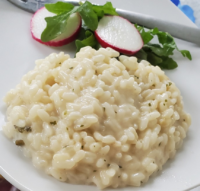 this is risotto and salad on a white plate