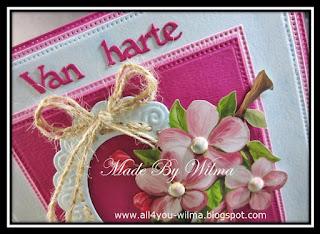 """Close-up van het felicitatiekaartje met """"Van harte"""" en het gebruikte touw. Close-up of the congratulatory card with """"Congrats"""" (Dutch words) and the used rope."""