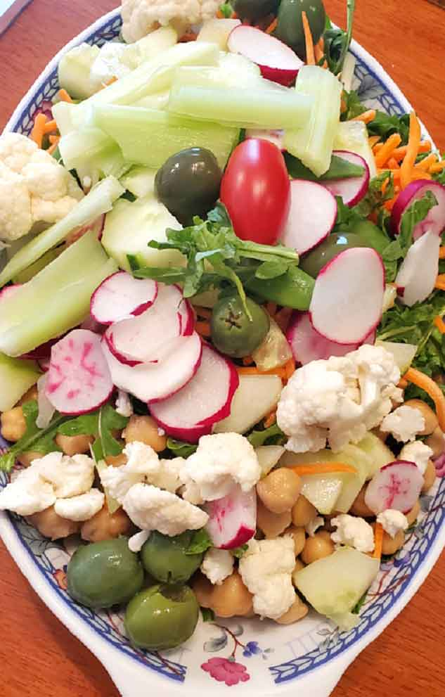 this is a dish of fresh cut up garden vegetables for a Greek Salad