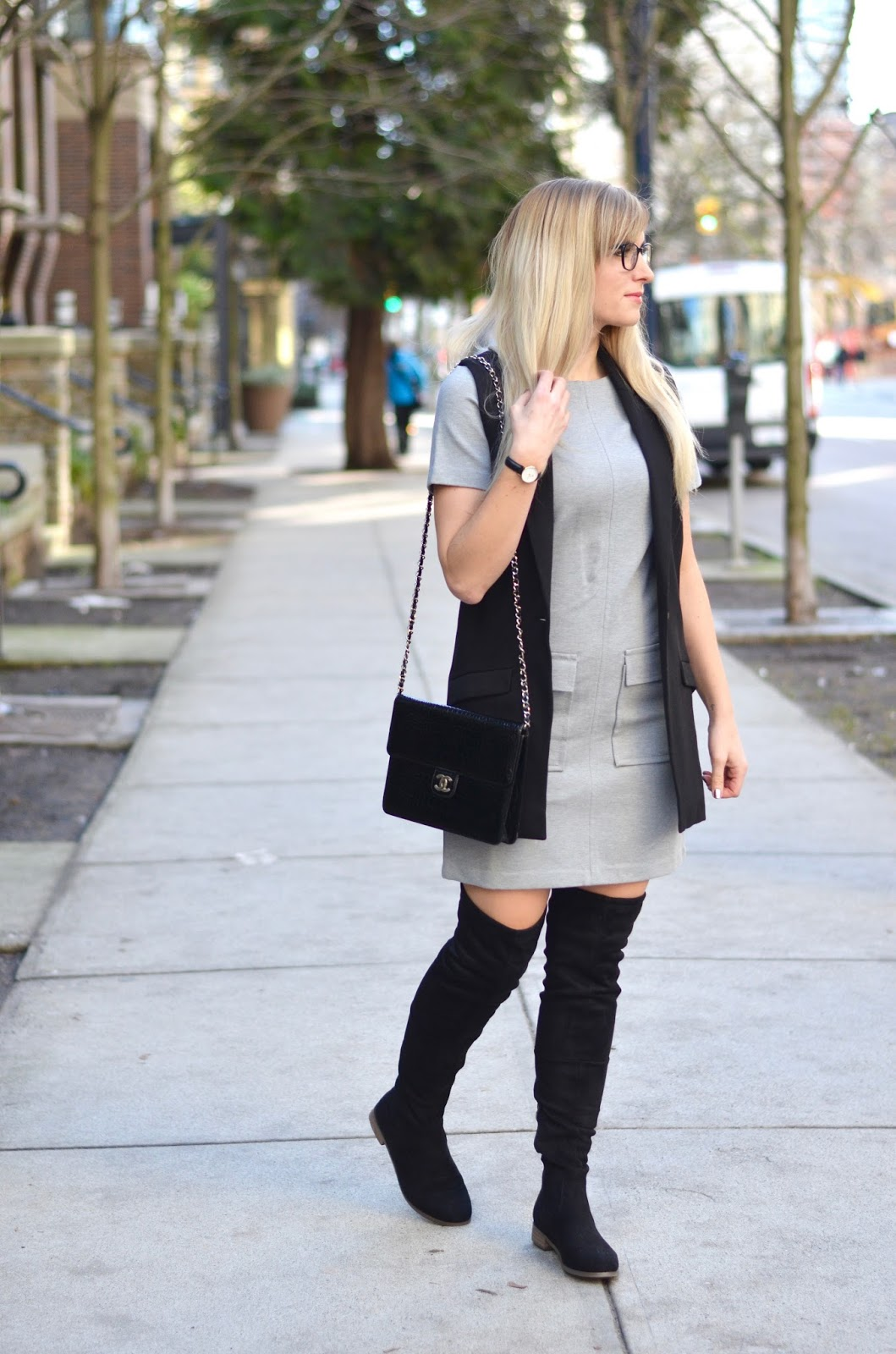 sleeveless blazer over a dress