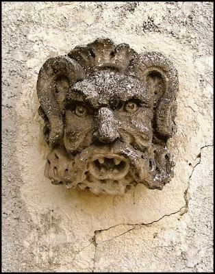 Face sculpture on wall at Montagu Gardens.