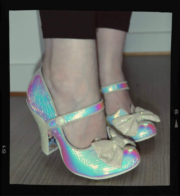 wearing rainbow holographic material shoes with bow