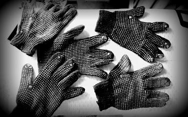 Five left-handed gloves.
