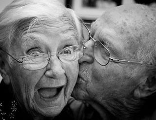 Older couple kissing, How To Be Rich In Love... In Just One Easy Way.